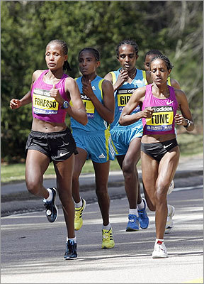 From left, elite runners Teyba Erkesso, Koren Yal, Waynishet Girma, and Dire Tune -- all from Ethiopia -- make their way through Wellesley.