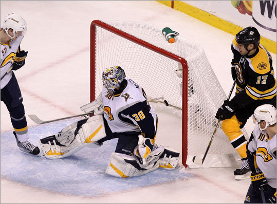 Milan Lucic (right) had a perfect view as Patrice Bergeron's shot beat Sabres goalie Ryan Miller for the game-winning goal in the third period. The Bruins beat the Sabres and took a 2-1 lead in their playoff series.