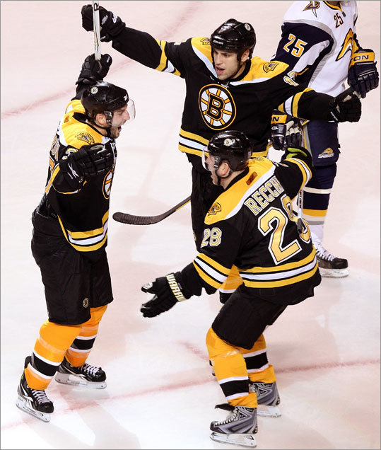 Patrice Bergeron (left) was the game's No. 1 star for his game-winning goal in the third period. He celebrated with Milan Lucic (center) and Mark Recchi.