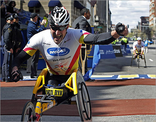 Ernst Van Dyk, the winner of the Men's Wheelchair Division, crossed the finish line with a smile.