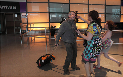 More trans-Atlantic flights landed yesterday at Logan International Airport as a volcanic ash cloud began to fade across European skies, reuniting some beleaguered travelers with their families. Click through this gallery for a look at some of these happy moments, and for scenes of the stranded from earlier this week. Vladimir Ovchinnikov (left) greeted his wife, Leah Ovchinnikov (center), and his daughter, Rachel, 12, after arriving at Logan's Terminal E on a flight from Frankfurt. He had been stranded in Germany for four days.