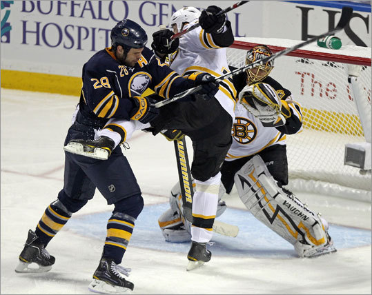 Bruins defenseman Zdeno Chara (right) and Sabres center Paul Gaustad battled in front of Bruins goalie Tuukka Rask in the first period.