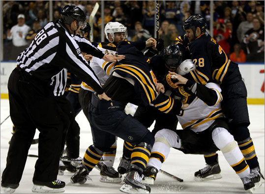 Bruins defenseman Zdeno Chara was gang-tackled by a number of Buffalo Sabres as time expired in the third period.