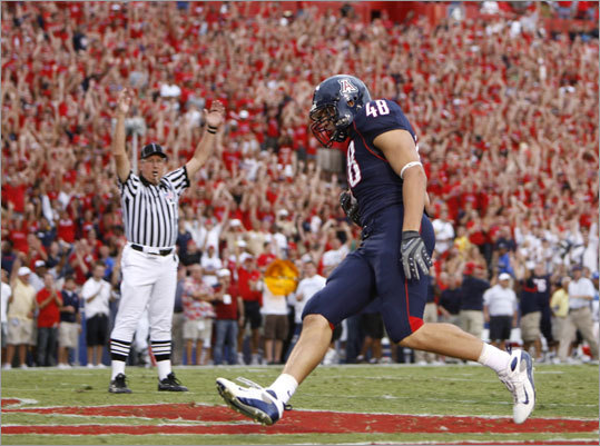 With the 42d overall pick, the Patriots chose Arizona tight end Rob Gronkowski, seen here scoring a touchdown vs. the Washington Huskies in 2008. Gronkowski missed the 2009 season with a back injury. He comes from a long line of football players: his father, Gordon, was a three-year starter on the offensive line at Syracuse, his brother, Dan, played at Maryland and is currently with the Lions, and another brother, Chris, also played for Arizona.