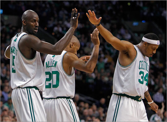 Celtics forward Kevin Garnett (left) got high fives from teammates Ray Allen and Paul Pierce after Garnett hit a first-half shot and was fouled.
