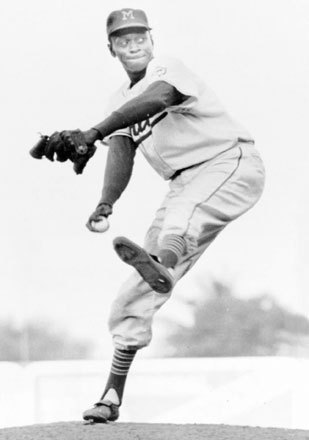 Pitcher Leroy Robert 'Satchel' Paige was, at 42, the oldest Major League rookie in history. Paige had starred in the Negro Leagues for years before his big league debut with Cleveland in 1948, but was barred from the Majors because of the color barrier. The lanky righty also holds the distinction of being the oldest player in Major League history, returning to the league in 1965 at age 59 to make a start for the Kansas City Athletics. Paige was elected to baseball's Hall of Fame in 1971.