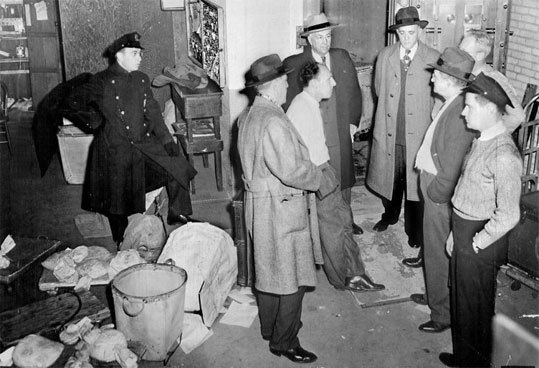 Police question Brinks employees on the night of Jan. 17, 1950, after the robbery of $3 million from the Prince Street building.