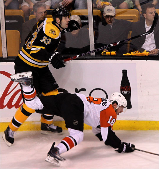 Bruins defenseman Zdeno Chara took out Flyers center Mike Richards along the boards.