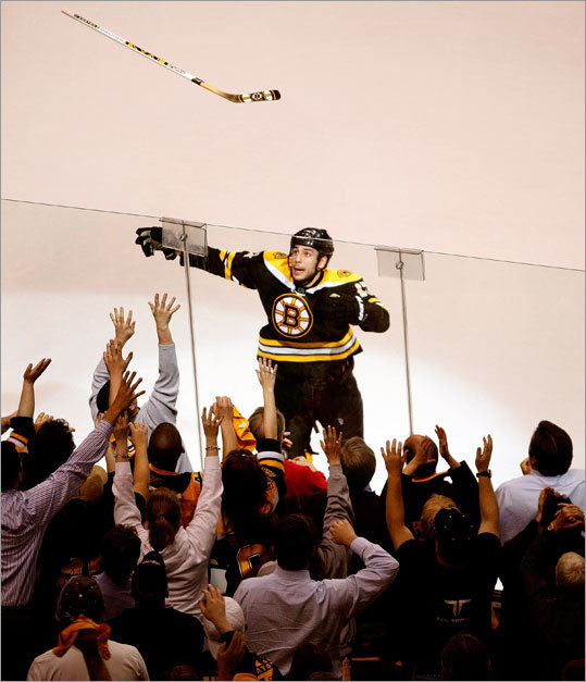 Bruins left wing Milan Lucic tossed a souvenir stick to the fans after he was named the No. 1 star of Monday's game. The Bruins beat the Flyers 3-2 and took a 2-0 lead in their Eastern Conference semifinal playoff series.