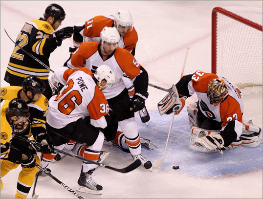 Flyers goalie Brian Boucher (33) pounced on a loose puck in front of the Flyer net in the first period.