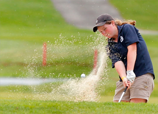 Mary Mulcahy of Scituate High School hits out of a bunker on the 14th hole at the MIAA State Girls Individual Golf Championship held at the Woodland Country Club in Newton, Monday May 3, 2010. Mulcahy shot a 5-over-par 77 to win the championship.