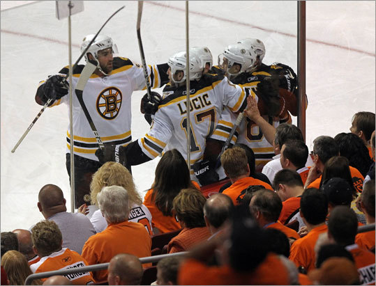 Bruins right wing Miroslav Satan (81) was surrounded by his celebrating teammates after Satan put the Bruins up 2-1.