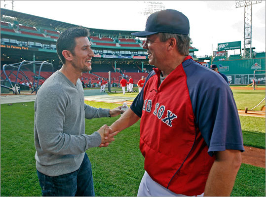 Former Red Sox shortstop Nomar Garciaparra (left) was honored on the field before the a May 5, 2010 game against the Los Angeles Angels. He was given two Fenway Park seats and a commemorative watch. He then briefly addressed the crowd, thanking them and saying he loved them, getting a nice ovation in response. Earlier, as the Red Sox finished batting practice, he said hello to bullpen coach Gary Tuck (right).