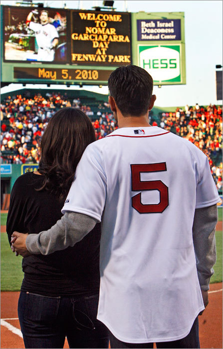 On 'Nomar Garciaparra Day,' former Red Sox shortstop Nomar Garciaparra took in the presentation on the big screen with his wife Mia Hamm on the field before the Sox played the Los Angeles Angels at Fenway Park Wednesday May 5, 2010.