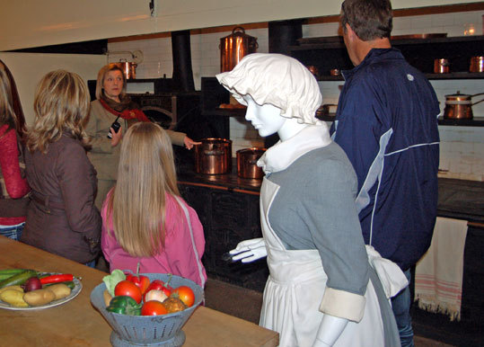 Tour guide Barbara Caldwell describes a typical day in the industrial-size kitchen at The Elms.