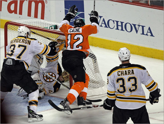 Flyers left wing Simon Gagne (center) scored the game-winning goal with 5:20 left in overtime. The Flyers' 5-4 victory over the Bruins Friday in Philadelphia pushed their NHL playoff series to a fifth game, which will be Monday night in Boston.