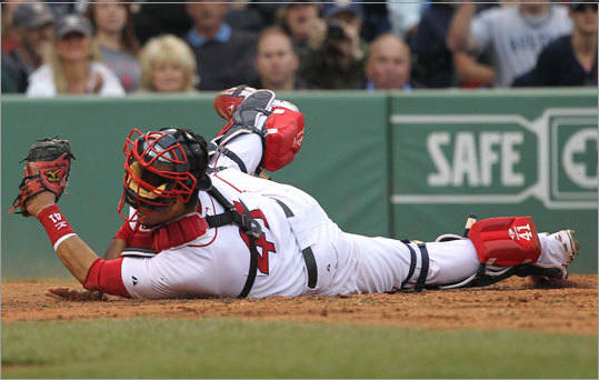 Victor Martinez holds on to the ball after tagging out the New York Yankees' Randy Winn in the fourth inning.