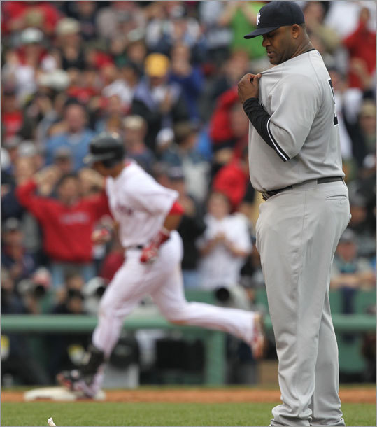 Victor Martinez touched third base after hitting as two-run home run off of New York Yankees starter C.C. Sabathia.