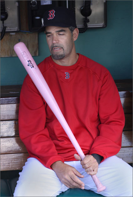 Mike Lowell holds one of the pink bats that some Red Sox players used during the game as part of Major League Baseball's ongoing effort to raise awareness about breast cancer. MLB staged the promotion to coincide with Mother's Day.