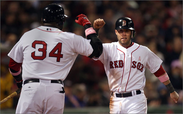 Dustin Pedroia (right) scored on a Kevin Youkillis double in the fourth inning to make it 7-2.