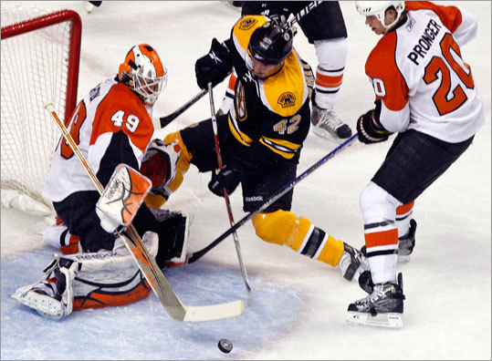 Flyers goalie Michael Leighton made 14 saves to complete a shutout, including this stop on Bruins center Trent Whitfield. Leighton replaced an injured Brian Boucher in the second period.