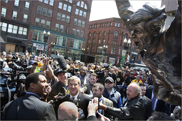 The crowd reacted as the statue was unveiled.