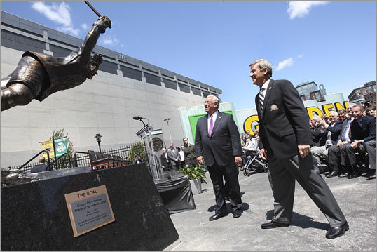 On Monday afternoon the Boston Bruins and TD Garden unveiled a bronze statue depicting the famous scene of Bobby Orr flying through the air immediately after scoring 'The Goal' that clinched the Bruins' 1970 Stanley Cup Championship over the St. Louis Blues. Orr and Mayor Thomas Menino looked at the unveiled statue shortly after the unveiling.