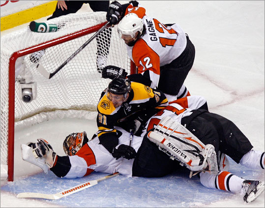 Flyers goalie Brian Boucher was injured on this second-period play when played from both teams fell on him. Boucher had to leave the game and was replaced by Michael Leighton.