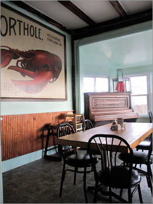 The Porthole ( 20 Custom House Wharf, 207-780-6533, www.portholemaine.com ) is a retro, unfussy dineresque joint hanging over the harbor. Think faded signs, more-faded linoleum, an old pot-bellied stove (replaced by a far more efficient gas one), an upright piano, hospital-green paneled walls, a counter full of salty character (and often, characters), and a pooch-friendly deck. Always popular for breakfast, it also serves lunch and, in summer, dinner. You can't go wrong with the $5.95 Shipyard Beer-battered fish 'n' chips, especially on Fridays, when it's the all-you-can-eat special.