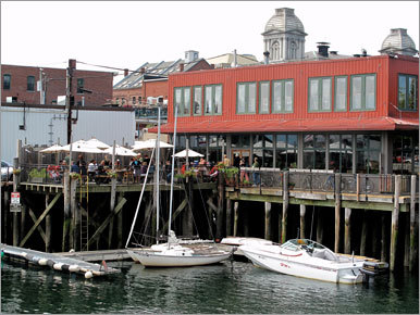 Here's a twofer with budget-friendly options and harbor views. Downstairs on the waterside is Flatbread ( 72 Commercial St., 207-772-8777, www.flatbreadcompany.com ), home of pizzas made with organic whole-grain flours, organic produce, free-range chicken, and nitrate-free meats. Sure, these are pricier than fast-food pizzas ($9-$10 small, $13-$18 large), but the atmosphere, flavors, and views are worth it. Sharing the building is Ri Ra ( 72 Commercial St., 207-761-4446, www.rira.com ), with a traditional Irish pub at street level and an upstairs dining room. Chicken pot pie, beef 'n' Guinness stew, emigrants' corned beef and cabbage are each $12.95.