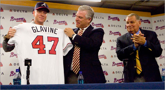 Tom Glavine, a native of Billerica, will have his uniform number 47 retired by the Atlanta Braves and be inducted into the team's hall of fame at a ceremony later this summer. The left-hander spent 17 seasons with the Braves and five with the Mets, amassing 305 victories and a career ERA of 3.54. He signed a one-year deal in November of 2007 that allowed him to complete his career with the Braves, and was intriduced by GM Frank Wren (center) and manager Bobby Cox. He now works as a Braves broadcaster and special assistant to the team president. Scroll through the gallery to see highlights from this local boy's illustrious career.