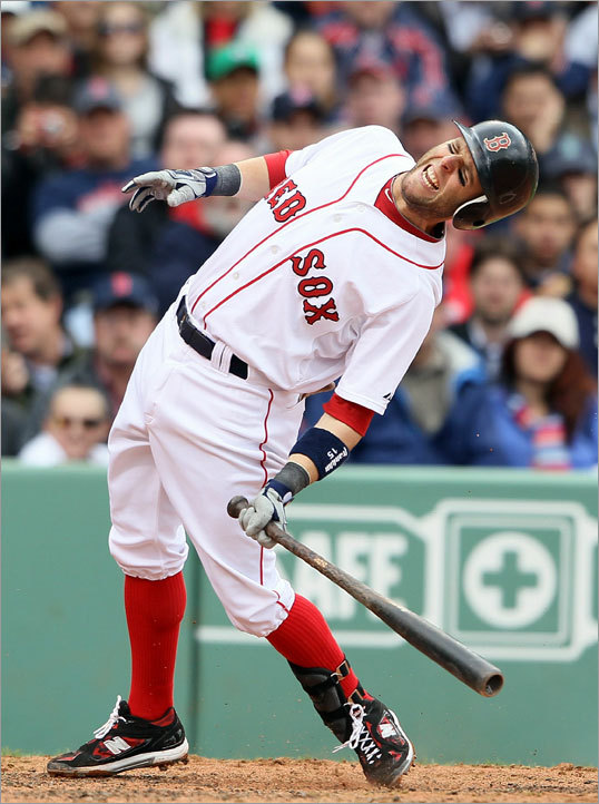 Dustin Pedroia reacted after getting hit by a pitch by Toronto's Shaun Marcum in the third inning.