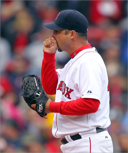 Red Sox starting pitcher Tim Wakefield blew on his hand in the third inning on a somewhat chilly day.