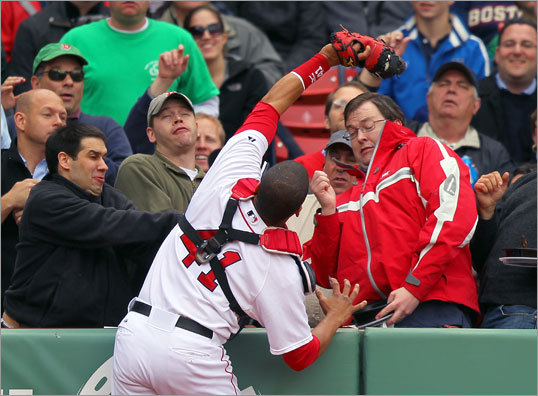 Red Sox catcher Victor Martinez caught a pop fly hit foul by Toronto's Fred Lewis (not pictured).