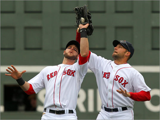 Red Sox left fielder Jeremy Hermida(left) caught a long fly hit by Toronto's Alex Gonzalez in the first inning. Hermida avoided colliding with Jonathan Van Every on the play.