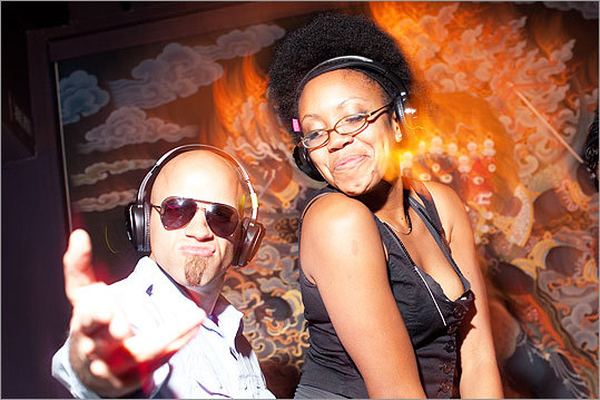 DJ Sterling Golden of Boston and Marita Banda of Brockton got down to the sounds of DJ Domonique. 'Last week we were all outside doing the electric slide,' Banda said. 'It was like everyone was your best friend.'