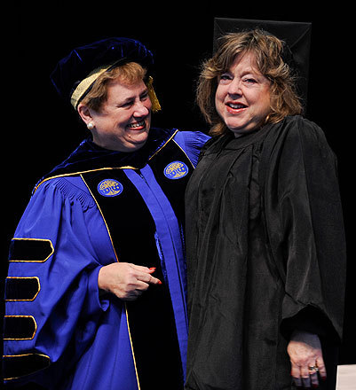 Simmons College President Helen Drinan (left) congratulated special honoree Faith Gobuty at the May 15 commencement. Gobuty had her bachelor's degree from Simmons 37 years ago but did not attend her commencement.