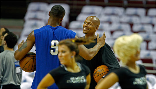 Orlando's Rashard Lewis (left) and the Celtics' Ray Allen chatted on the court with the Magic Dancers (foreground) getting ready for today's game.