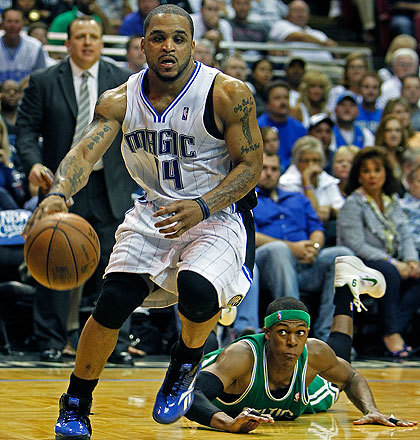 The Magic's Jameer Nelson left Rajon Rondo in the background as he drove to the hoop as Orlando stormed back from a 20-point deficit.