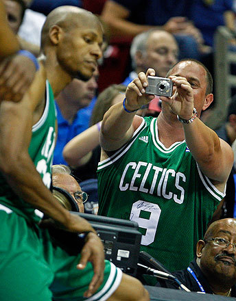 Rajon Rondo has done it all this postseason -- except take team photos. This isn't Rondo shooting an image of Celtics guard Ray Allen, just a fan.