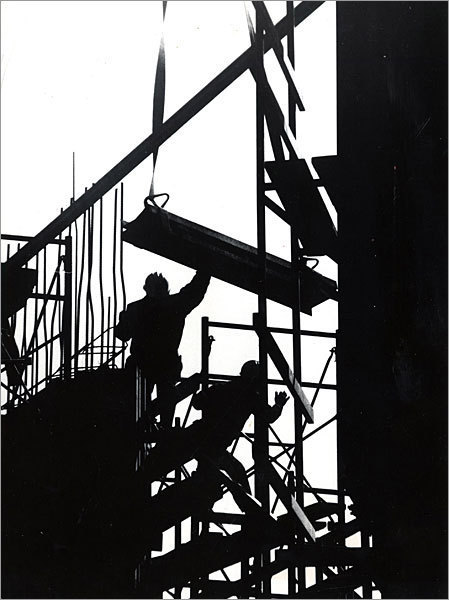 Workers are silhouetted against the sky in this photo of the construction site in 1971.
