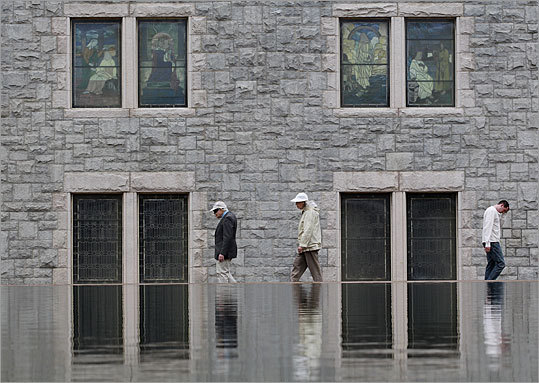 The specific plan for reconstructing the reflecting pool is still under discussion and would need approval from the Boston Landmarks Commission, which granted protected status to the pool and plaza earlier this year. Left: Windows from the church are reflected in the 686-foot-long reflecting pool that anchors the church's sprawling concrete plaza at Massachusetts and Huntington avenues.