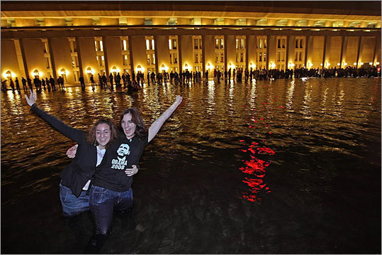 The reflecting pool has also been the scene for impromptu celebrations, such as the one shown here that took place soon the night Barack Obama was elected president in 2008.