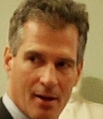 Senator Scott Brown withheld support until the bill contained provisions protecting Bay State financial firms.