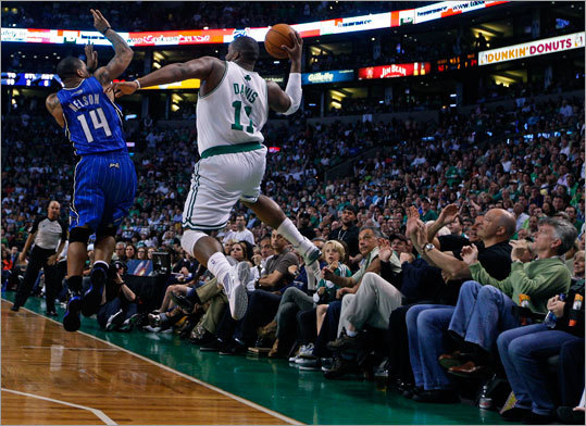 The Celtics' Glen Davis mades a save as the ball was about to go out of bounds. The Magic's Jameer Nelson defended the play in the first half.