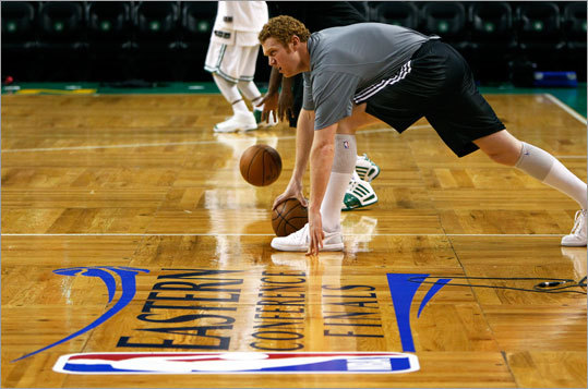 The Celtics' Brian Scalabrine loosened up on the floor about three hours before tapoff.