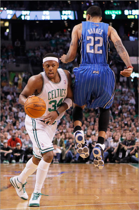 The Celtics' Paul Pierce (left) drove around the Magic's Matt Barnes in the first quarter of Game 3 of their NBA Eastern Conference playoff series in Boston.