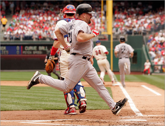 After hitting a triple, Kevin Youkilis scored on a ground out by J.D. Drew during the second inning.