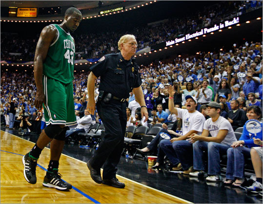Celtics center Kendrick Perkins was escorted off the floor as fans waved goodbye after he was ejected from the game. He received two technical fouls in the first half.