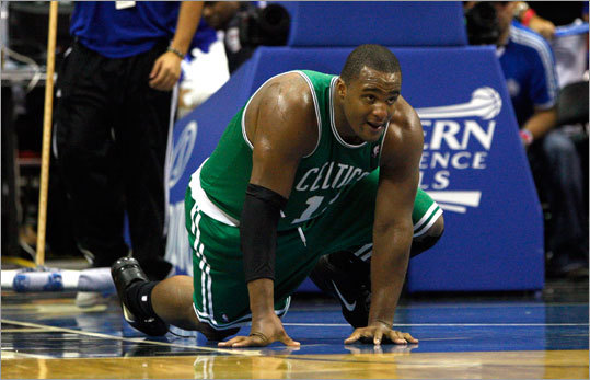 Celtics forward Glen Davis tried to get back in the action after being elbowed by Dwight Howard, but he couldn't get his balanced and had to be helded by teammates and a referee..